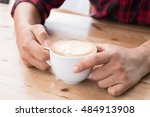 young hands holding cup of... | Shutterstock . vector #484913908