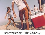 friends on the beach. rear view ... | Shutterstock . vector #484953289