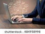 an office worker sending emails ... | Shutterstock . vector #484958998