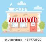 facade cafe with a signboard ...