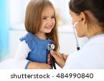 doctor examining a little girl... | Shutterstock . vector #484990840