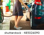 woman fills petrol into her car ... | Shutterstock . vector #485026090