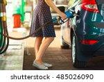 woman fills petrol into her car ... | Shutterstock . vector #485026090