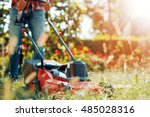 Close Up Of Mower Cutting The...