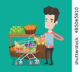 young man standing near trolley ... | Shutterstock .eps vector #485065810