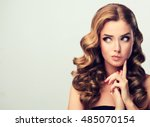 frowning  the woman looks away... | Shutterstock . vector #485070154