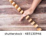 close up hand stop woonen block.... | Shutterstock . vector #485130946