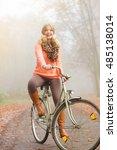 happy active woman riding bike... | Shutterstock . vector #485138014
