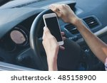 hands with mobile phone driving | Shutterstock . vector #485158900