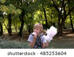 boy eating cotton candy at the... | Shutterstock . vector #485253604