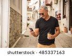 beautiful handsome man holding...   Shutterstock . vector #485337163