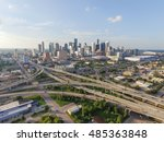 Small photo of Aerial view downtown and interstate 45 and 69 highway intersection, massive intersection, stack interchange and elevated road junction overpass at sunset from the southeast side of Houston, Texas, USA