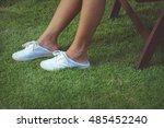 legs in skirt and white slip... | Shutterstock . vector #485452240