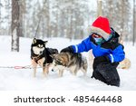 boy having a cuddle with husky... | Shutterstock . vector #485464468