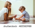 mom playing with her son with... | Shutterstock . vector #485583988