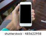 close up hand holding smartphone | Shutterstock . vector #485622958