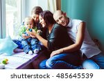mother show a toy to her little ... | Shutterstock . vector #485645539