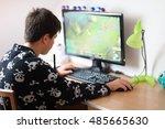 teenager boy using computer at...   Shutterstock . vector #485665630