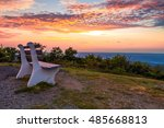 A lone bench looks over the mountain at sunset at the top of New Jersey