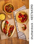 hot dogs with roasted veggies... | Shutterstock . vector #485764390