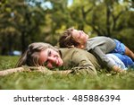 little girl lying on the mother ... | Shutterstock . vector #485886394