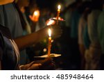 People Hold Candles Light At...