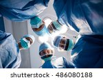 group of surgeons looking at... | Shutterstock . vector #486080188