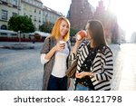 two cute girls tourists talk... | Shutterstock . vector #486121798