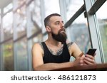 young bearded man with mobile... | Shutterstock . vector #486121873
