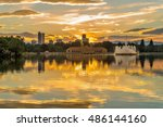 Golden Sunset at City Park - A summer sunset view of Ferril Lake in Denver City Park, with city skyline and front range mountains in the background, at east-side of Downtown Denver, Colorado, USA.