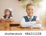 happy schoolboy sitting at desk ... | Shutterstock . vector #486211228