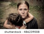 a woman holds a child  trying... | Shutterstock . vector #486239008