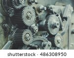old gears in black oil | Shutterstock . vector #486308950
