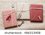 gift wrapped in craft paper | Shutterstock . vector #486313408