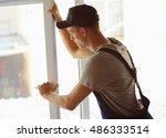 construction worker installing... | Shutterstock . vector #486333514