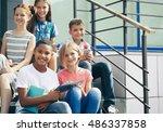 schoolchildren with mobile... | Shutterstock . vector #486337858
