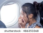 frightened woman looking out an ... | Shutterstock . vector #486353368