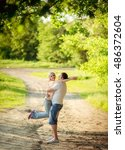 young couple in love on park... | Shutterstock . vector #486372604