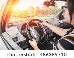 female driving car. vintage... | Shutterstock . vector #486389710