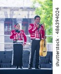 Small photo of GUADALAJARA , MEXICO - AUG 28 : Mariachis perform on stage at the 23rd International Mariachi & Charros festival in Guadalajara Mexico on August 28 , 2016.