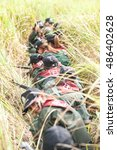 Small photo of SURATTHANI THAILAND- Sep. 17: Women police tactical training program annual review ambush patrols and the use of weapons in the woods. Sep 17, 2016 in suratthani province,Thailand