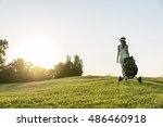 pretty young woman playing golf.... | Shutterstock . vector #486460918