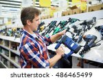 man shopping for perforator in... | Shutterstock . vector #486465499