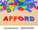 Small photo of Colorful alphabet with word afford