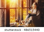 happy young woman reading a... | Shutterstock . vector #486515440