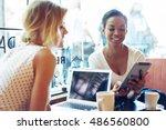 two entrepreneurs are smiling... | Shutterstock . vector #486560800