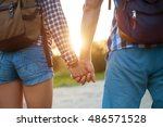 hiker young woman holding man's ... | Shutterstock . vector #486571528