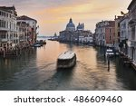 Small photo of Basilica Di Santa Maria and palaces south from Academia bridge on Grand Canal in Venice, Italy. Vaporetto breaks still sunrise water of Venice.