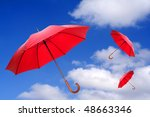 Three Red Umbrellas Flying In ...
