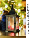 glowing candle lantern on the... | Shutterstock . vector #486647590